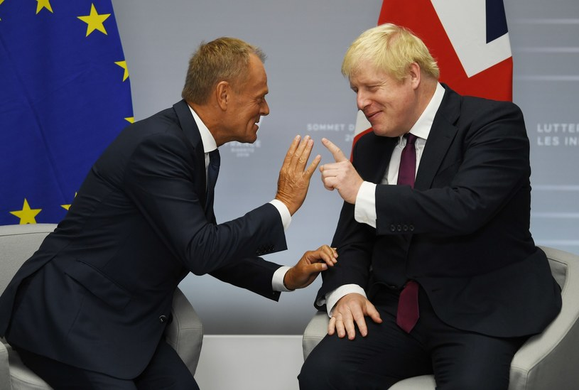 Donald Tusk i Boris Johnson podczas spotkania w trakcie szczytu G7 /Neil Hall/Press Association /East News