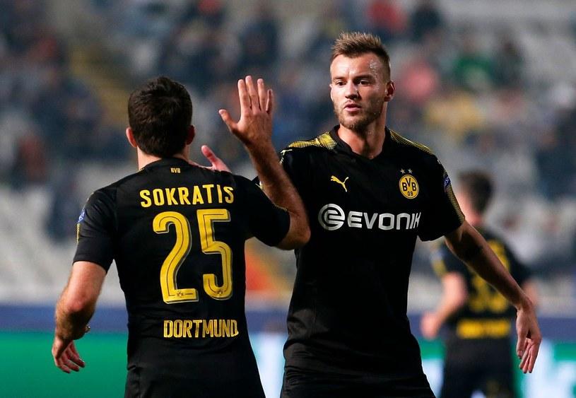 Dwaj piłkarze, którzy w letnim okienku opuścili Borussię Dortmund: Sokratis (Arsenal) i Andrij Jarmołenko (West Ham) /FLORIAN CHOBLET /AFP