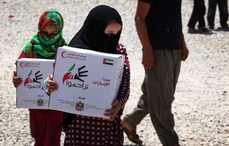 Dżihadyści werbują nieletnich, by walczyli u ich boku; na zdjęciu dzieci uchodźców uciekających przed IS /SAFIN HAMED / AFP /AFP