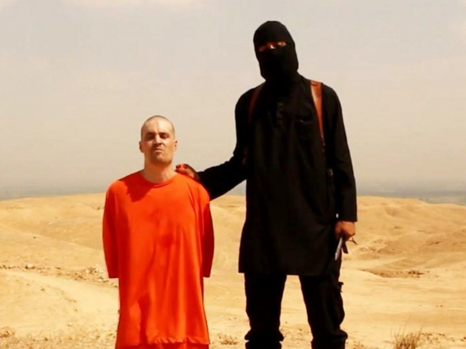 Dżihadysta na nagraniu z egzekucji Jamesa Foleya /PAP/Newscom  /PAP/EPA