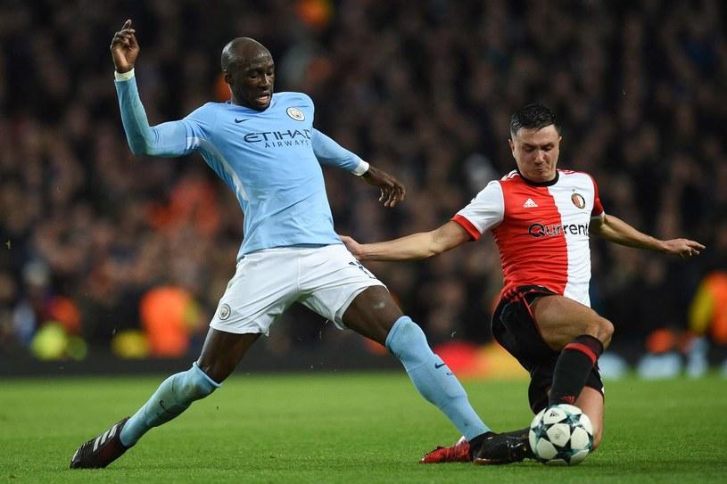 Eliaquim Mangala (z lewej) i Steven Berghuis z Feyenoordu /AFP