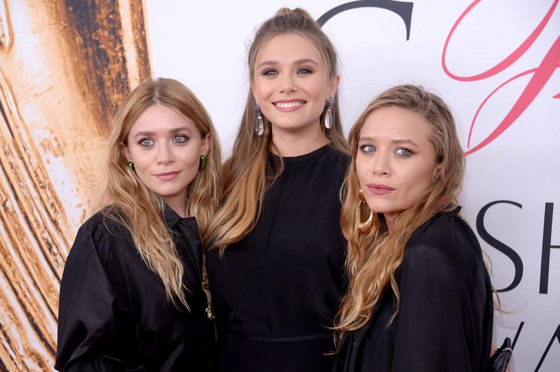 Elizabeth Olsen (w środku), Mary-Kate, Ashley Olsen /Clint Spaulding/Patrick McMullan /Getty Images