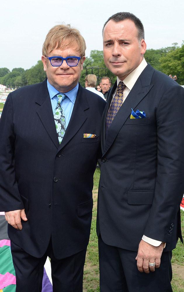 Elton John, David Furnish /Michael Kovac /Getty Images
