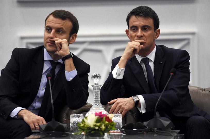 Emmanuel Macron (L) i Manuel Valls (P) /FAROUK BATICHE /AFP