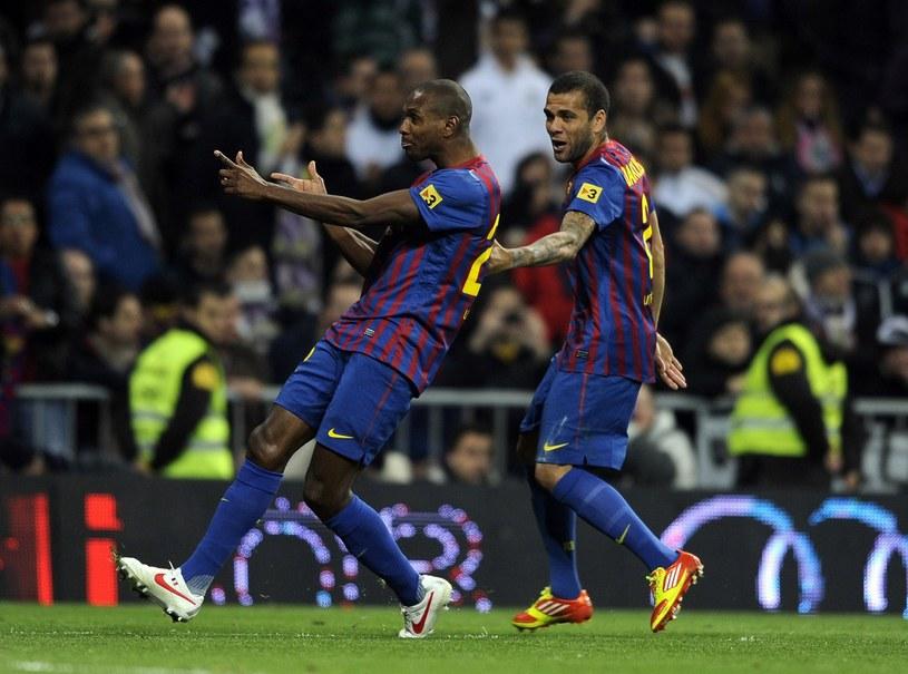 Eric Abidal i Dani Alves /AFP