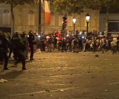 Francuscy fani starli się z policją w Paryżu po awansie do finału MŚ. Wideo