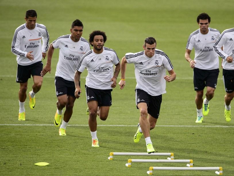 Gareth Bale i jego koledzy ostro trenują przed derbami /AFP