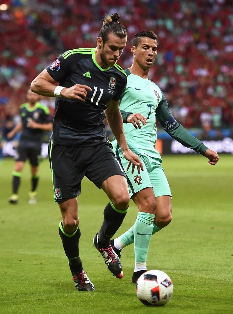 Gareth Bale (z lewej) musiał uznać wyższość drużyny Cristiana Ronalda /AFP