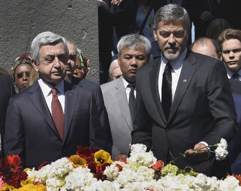 George Clooney u boku prezydenta Armenii /AFP
