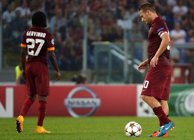 Gervinho i Francesco Totti mają o czym myśleć /AFP