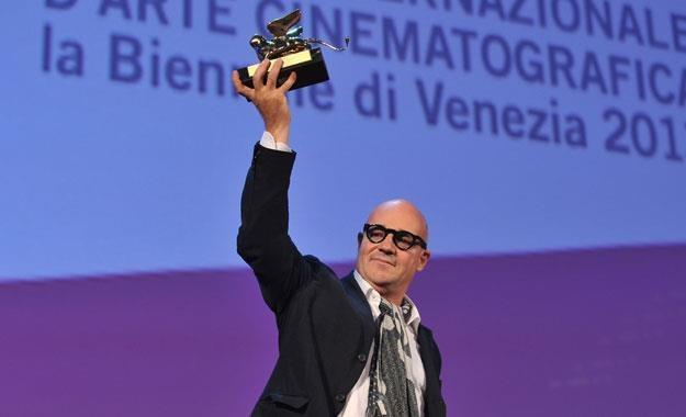 Gianfranco Rosi ze Złotym Lwem /AFP