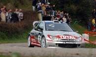 Gilles Panizzi w Peugeocie 206 WRC podczas I etapu