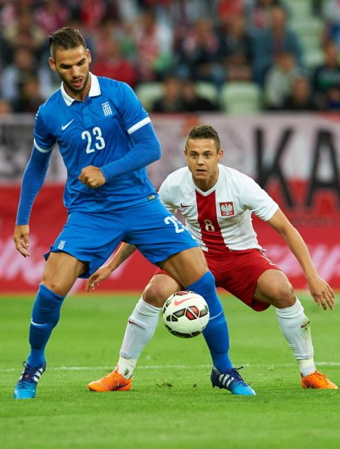 Gracz reprezentacji Polski Ariel Borysiuk i Grek Panagiotis Tachtsidis /PAP/Adam Warżawa    /PAP