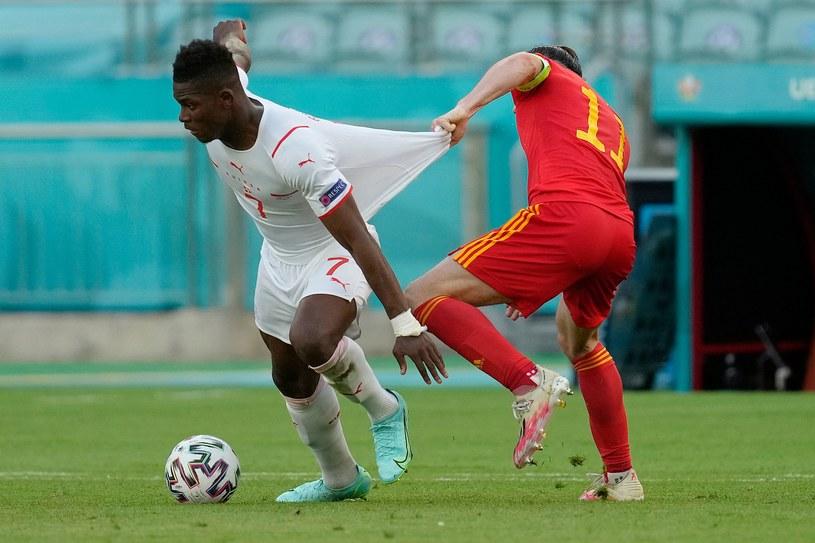 Gracze reprezentacji Walii nie mogli dziś powstrzymać Embolo /Darko Vojinovic / AP Photo /AFP