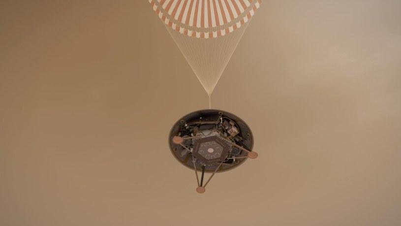 Grafika prezentująca etap lądowania InSight na spadochronie /NASA
