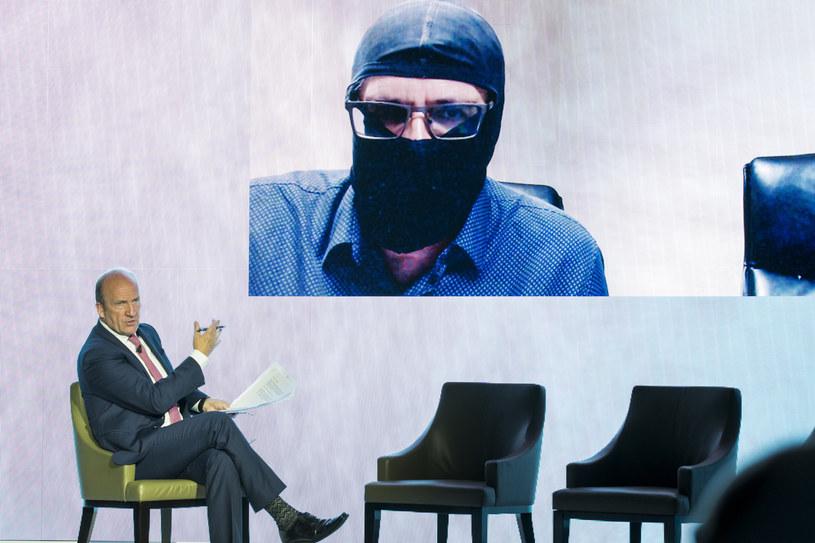 Grigorij Rodczenkow (z zasłoniętą twarzą) podczas wywiadu /Getty Images