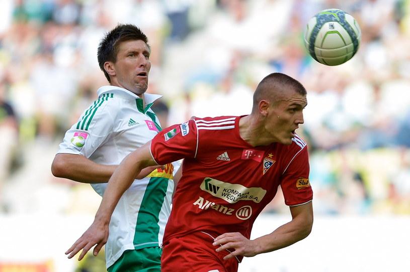 Grzegorz Rasiak (z lewej) już nie będzie grał w Lechii Gdańsk /Fot. Adam Warżawa /PAP