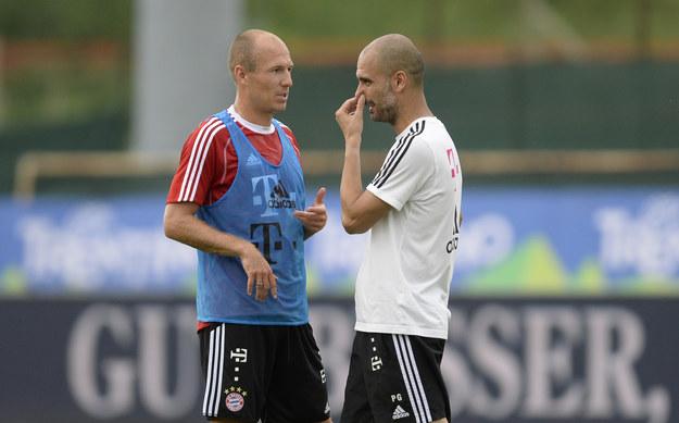 Gwiazda Bayernu Monachium - Arjen Robben (z lewej) i trener Pep Guardiola /AFP