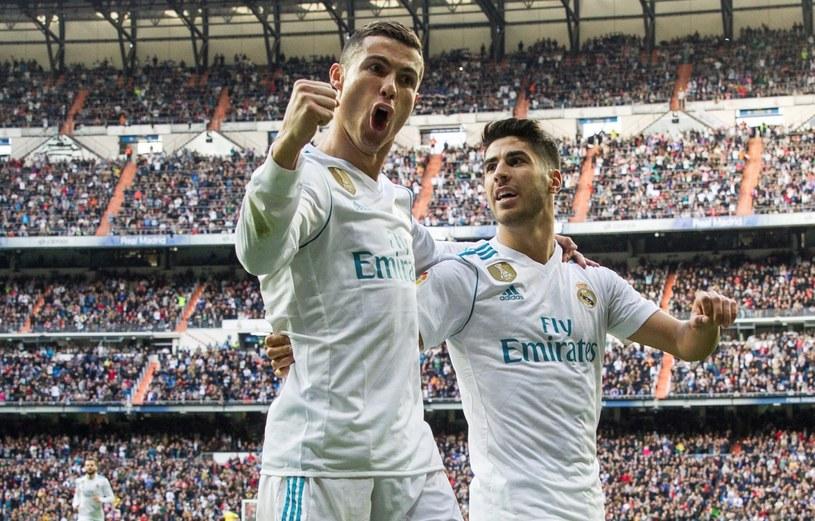 Gwiazdy Realu Madryt - Cristiano Ronaldo (z lewej) i Marco Asensio /PAP/EPA