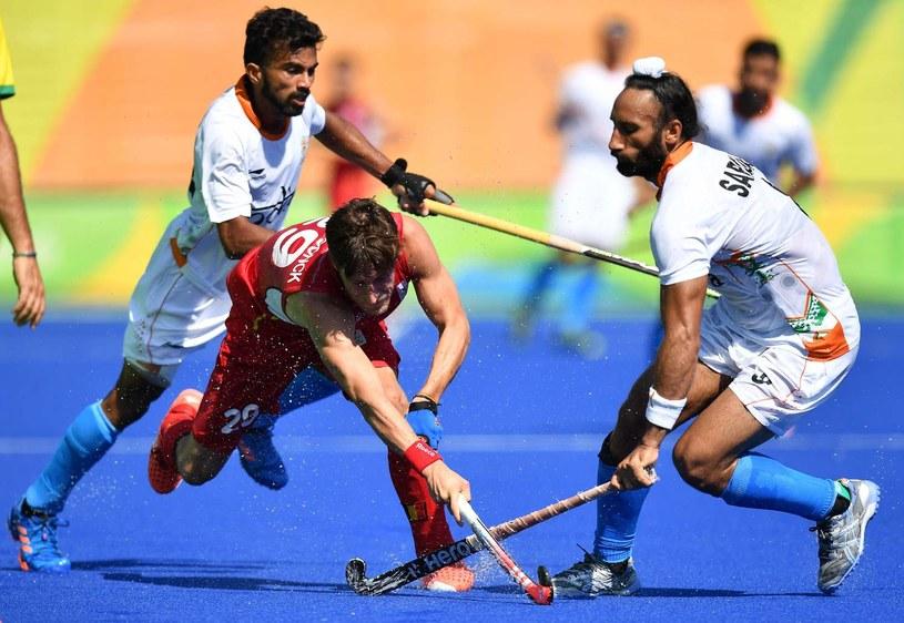 Hokeiści na trawie Indii (na biało) zdobyli już 11 medali olimpijskich /AFP