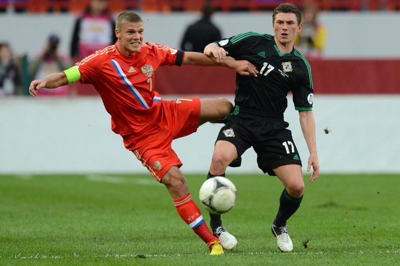 Igor Denisow (z lewej) został przesunięty do rezerw Zenita /AFP