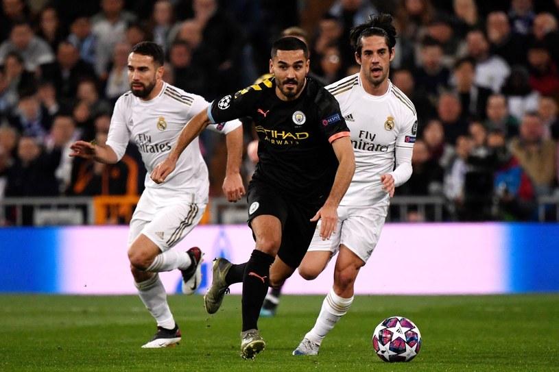 Ilkay Gundogan w meczu z Realem Madryt w Lidze Mistrzów /AFP