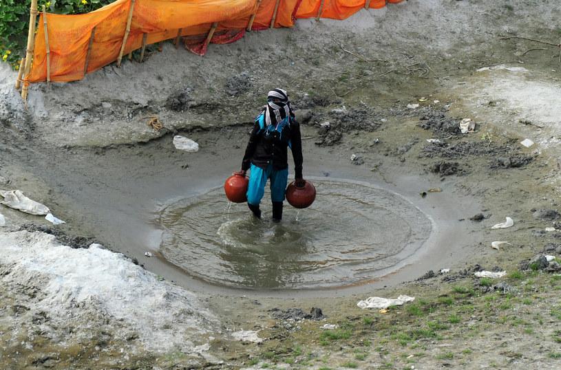 Indyjski farmer, jedna z wielu osób, których życie jest ściśle związane z Gangesem /AFP