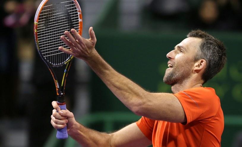 Ivo Karlović cieszy się ze zwycięstwa z Novakiem Djokoviciem /AFP