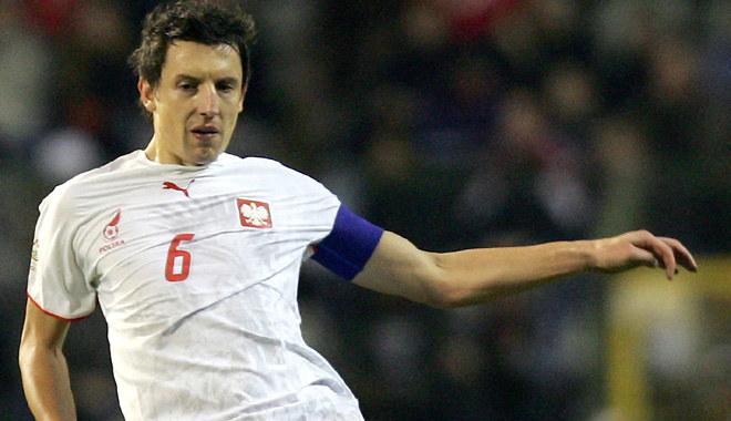 Jacek Bąk w koszulce reprezentacji Polski /AFP