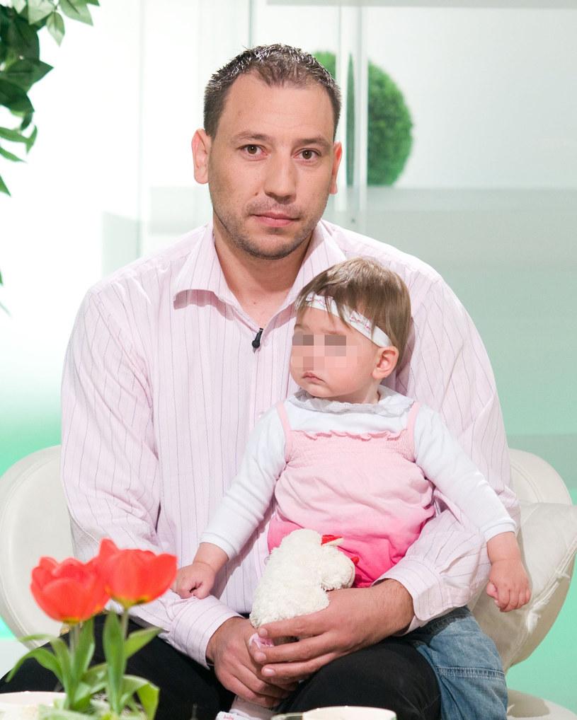 Jacek Olszewski z córeczką, zdjęcie z 2009 roku /Piotr Wygoda /East News