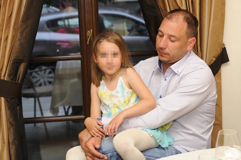 Jacek Olszewski z córką, 2013 rok /Niemiec /AKPA