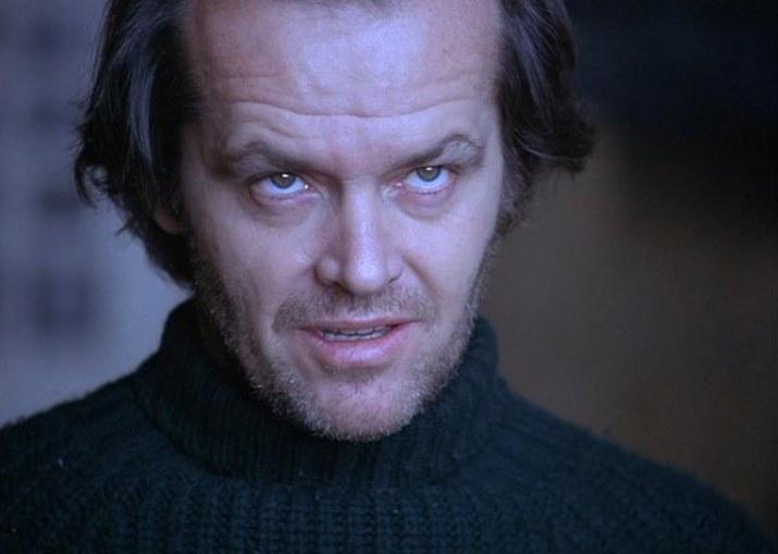"""Jack Nicholson jako Jack Torrance w filmie Stanley'a Kubricka """"Lśnienie"""" (1980) /materiały prasowe"""
