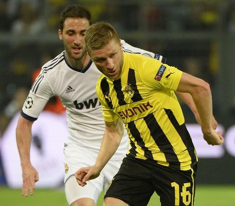 Jakub Błaszczykowski i Gonzalo Higuain podczas meczu Borussii Dortmund z Realem Madryt /AFP