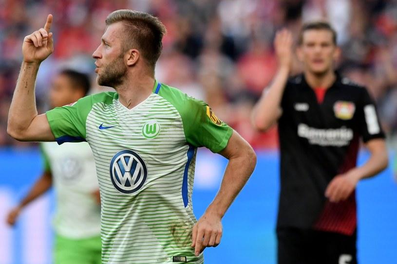 Jakub Błaszczykowski (L) cieszy się z gola w meczu z Bayerem Leverkusen /Sascha Steinbach /PAP/EPA