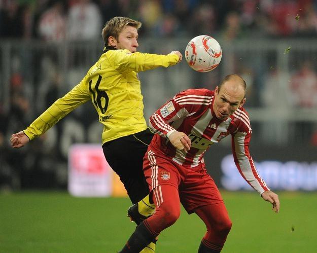 Jakub Błaszczykowski (z lewej) w zimie prawdopodobnie opuści Borussię Dortmund /AFP