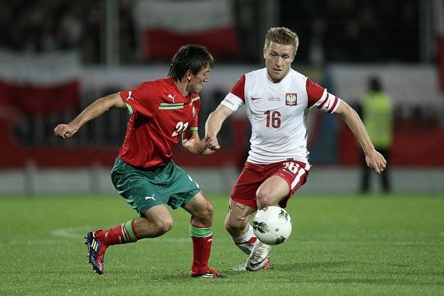 Jakub Błaszczykowski (z prawej) był najlepszym piłkarzem w szeregach Orłów Smudy /AFP