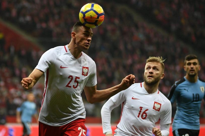 Jakub Błaszczykowski (z prawej) i Jarosław Jach w meczu z Urugwajem. /Bartłomiej Zborowski /PAP
