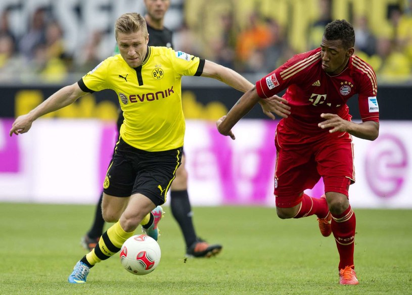 Jakub Błaszczykowski znów będzie toczył zażarte boje z piłkarzami Bayernu /AFP