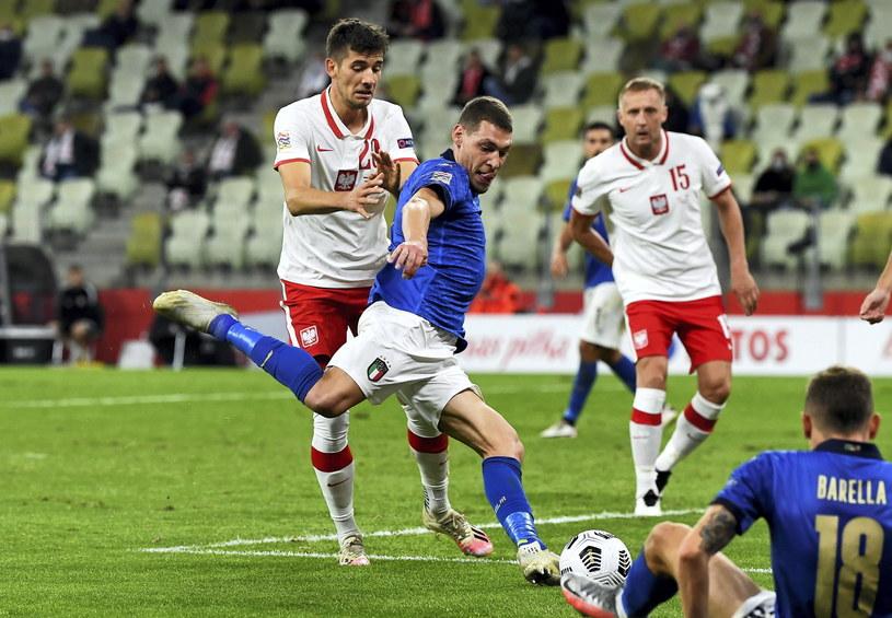 Jakub Moder w meczu z Włochami / Adam Warżawa    /PAP