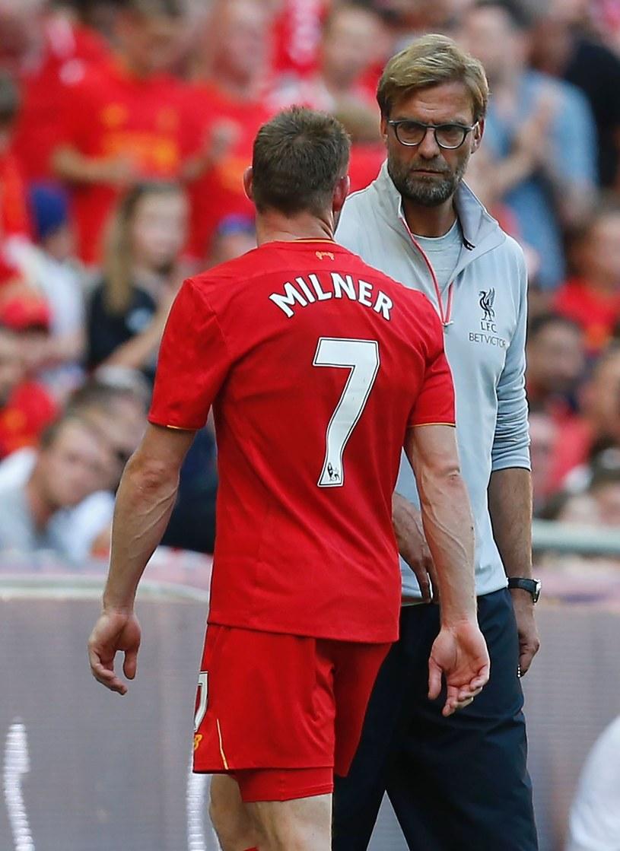 James Milner i Juergen Klopp. /AFP
