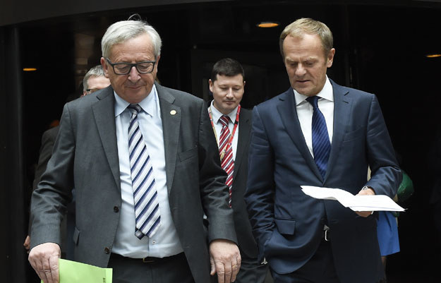 Jean-Claude Juncker i Donald Tusk po spotkaniu na szczycie /AFP