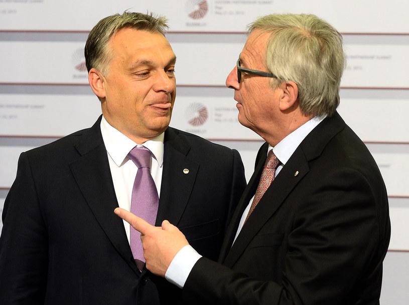 Jean-Claude Juncker (po prawej) z premierem Węgier Victorem Orbanem /AFP