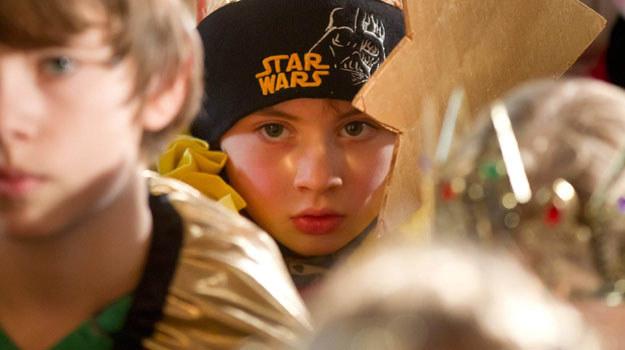 """Jeden z młodszych fanów """"Gwiezdnych wojnen"""" /AFP"""