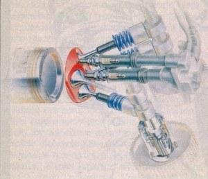 Jedna podwójna cewka zapłonowa, dwie świece, 2 wałki rozrządu i 4 zawory. Takim zestawem obdarzony jest każdy z cylindrów. Na wałku ssącym widoczny jest regulator faz rozrządu. /Motor