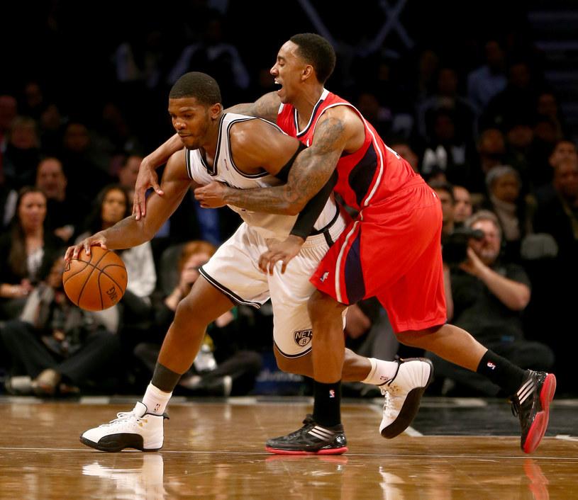 Jeff Teague z Atlanta Hawks i Joe Johnson z Brooklyn Nets /AFP