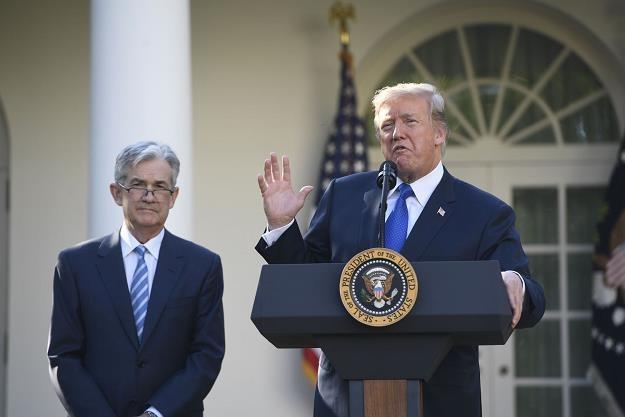 Jerome Powell (L), Donald Trump /AFP