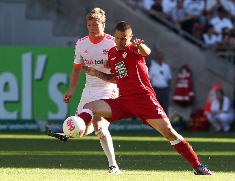 Jeszcze niedawno Ariel Borysiuk (z prawej) rywalizował z Tonym Kroosem, a teraz będzie walczył z Lechią Gdańsk o mistrzostwo Polski. /AFP