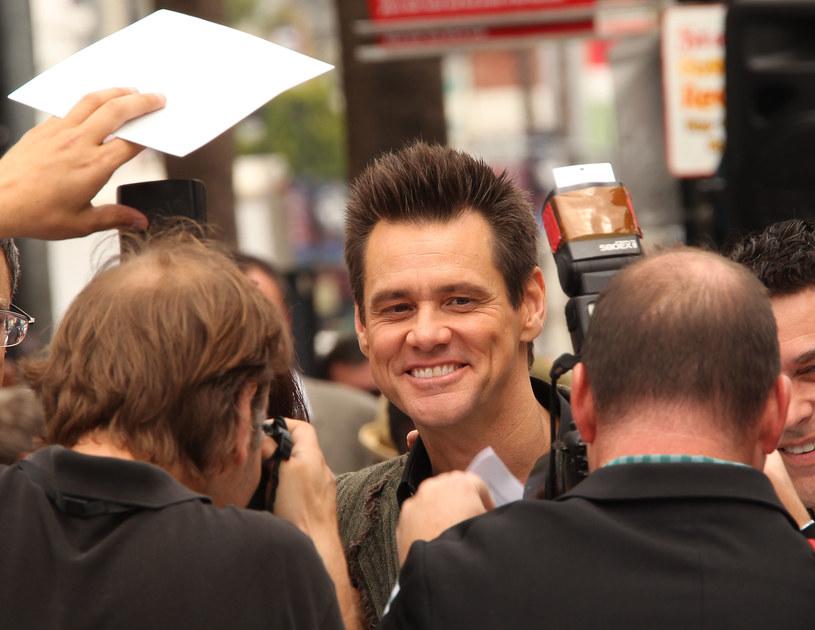 Jim Carrey pod ostrzałem fotoreporterów (2011) /Frederick M. Brown /Getty Images