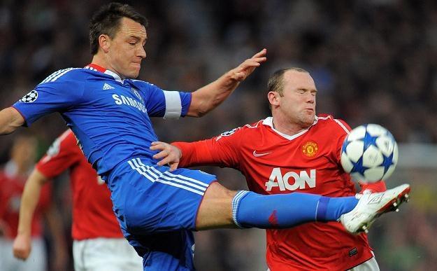 John Terry musi uważnie pilnować Wayne'a Rooneya /AFP