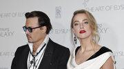 Johnny Depp i Amber Heard na lotnisku